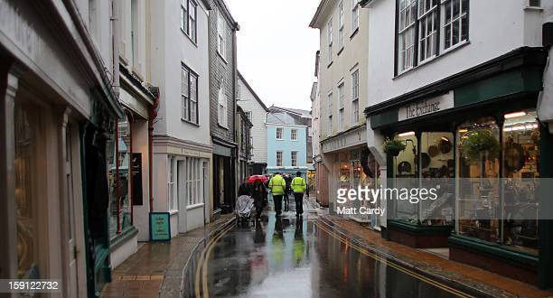 People pass shops along the main shopping street of Totnes on January 8 2013 in Totnes England The Devon town is renowned for its belief in promoting...