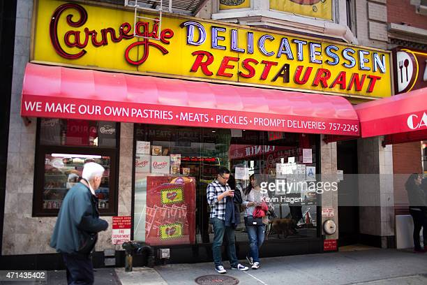 People pass the Carnegie Delicatessen in Manhattan after it was shut down over an investigation into tampering with natural gas lines April 28 2015...