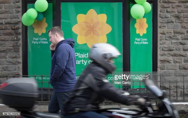 People pass the office for Plaid Cymru on May 5 2017 in Pontypridd Wales After making a number of gains in last night's council elections in Wales...