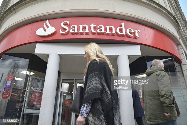 People passing a branch of the Santander Bank in Manchester Greater Manchester England United Kingdom on Wednesday 30th March 2016 The UK banking...