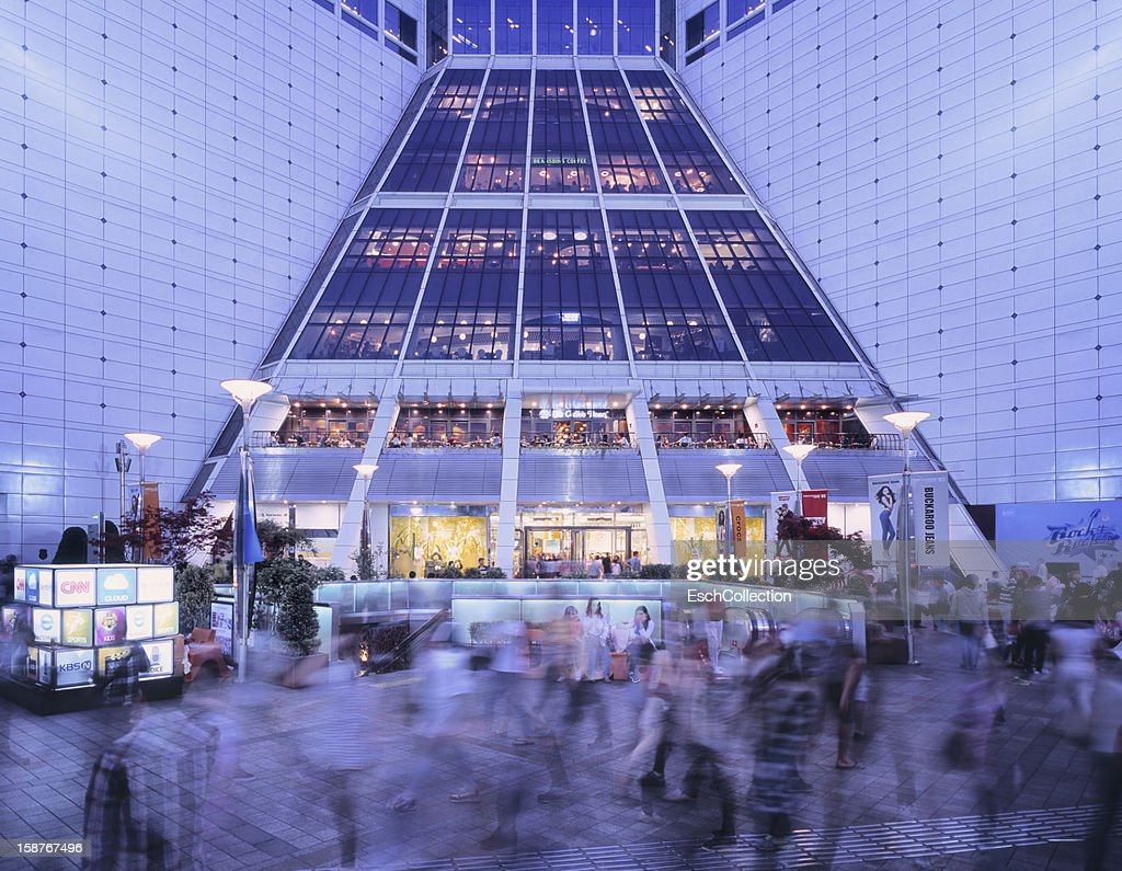 People passing Doota shopping mall in Seoul : Stock Photo