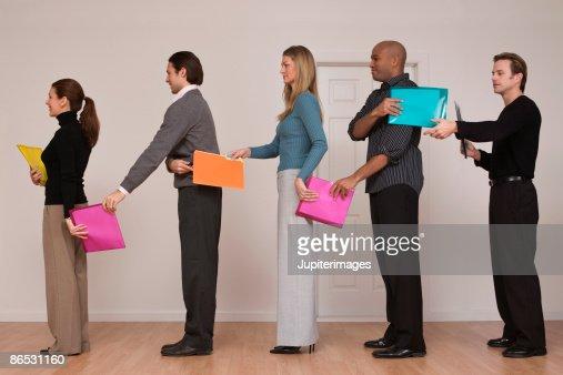 People passing folders