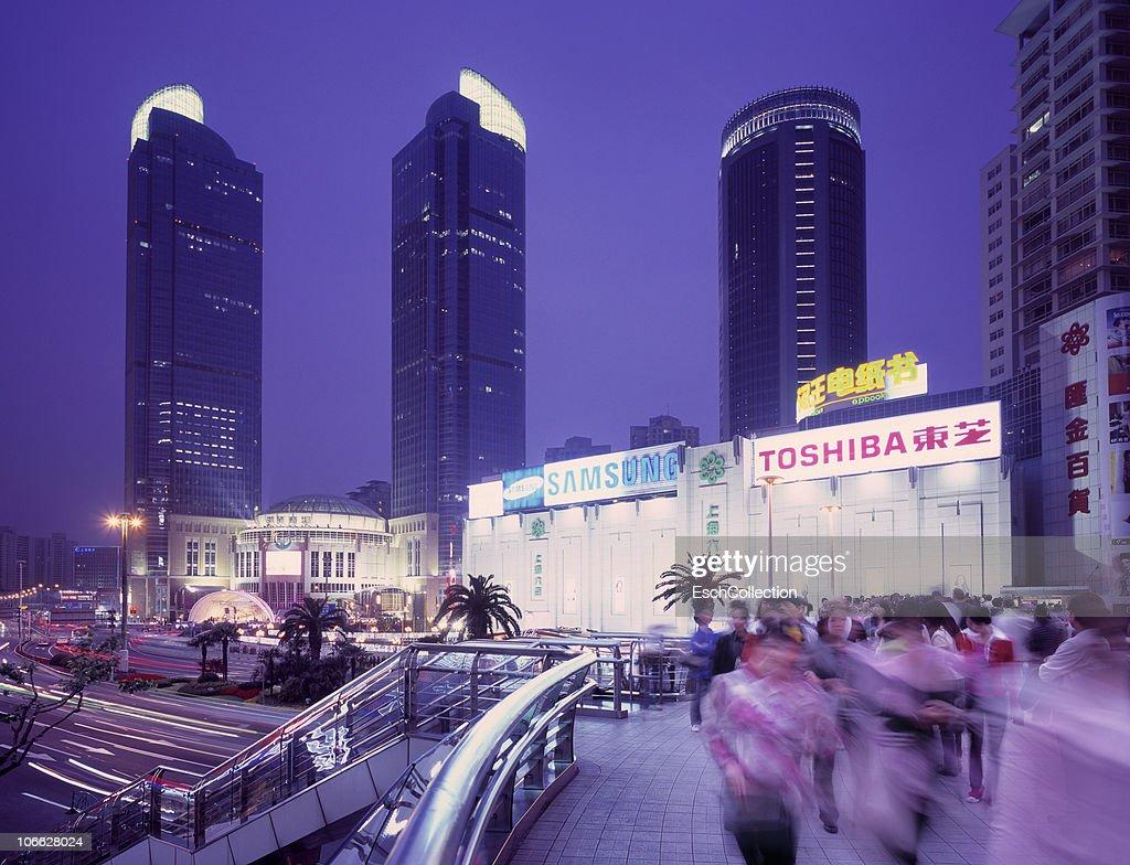 People passing walkover at Xujiahui, Shanghai. : Stock Photo