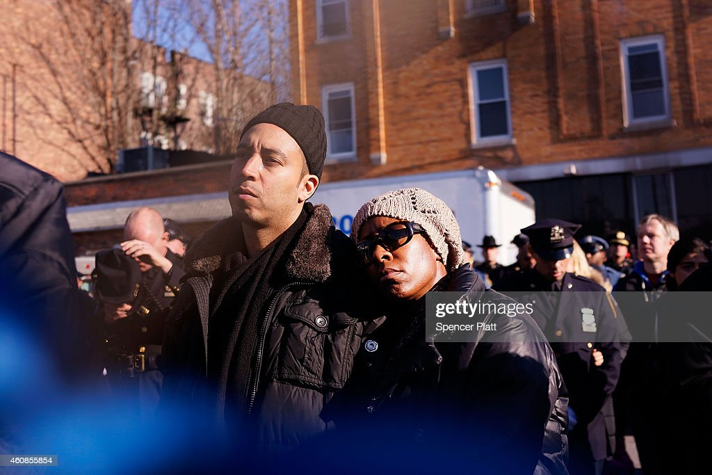 People pause outside of the Christ Tabernacle Church for the funeral of slain New York City Police Officer Rafael Ramos one of two officers murdered...