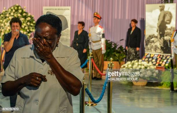 TOPSHOT People pay their last respects to Cuban revolutionary icon Fidel Castro kicking off a series of memorials in Havana on November 28 2016 A...