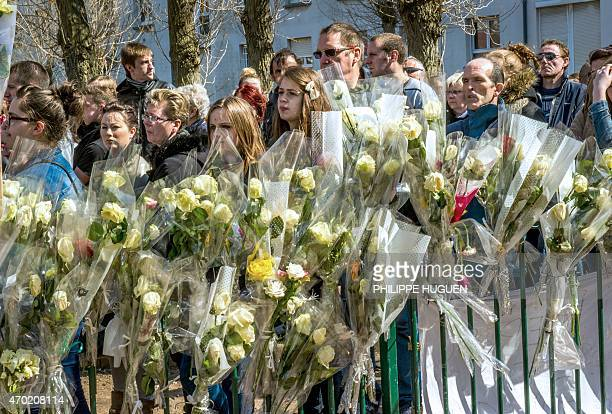 People pay their respect on April 18 2015 to nineyearoldgirl Chloe who was raped and killed by a 38yearold Polish man on April 15 at the site of her...