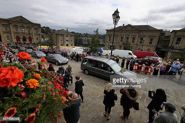 People pay their respects as the funeral cortege of murdered member of parliment Jo Cox processes through Batley Market Place in her constituency on...