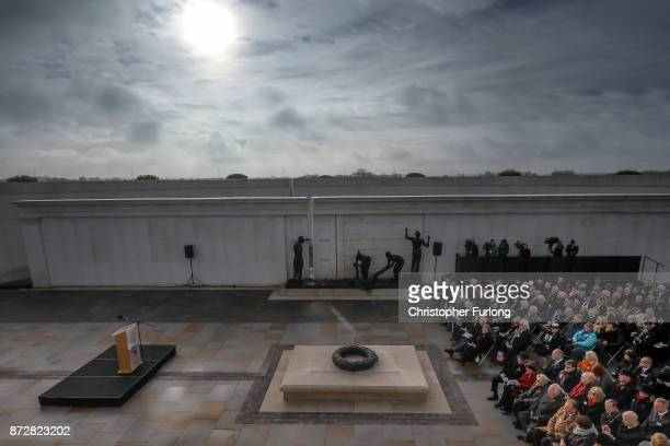 People pay their respects as they the annual Armistice Day Service at The National Memorial Arboretum on November 11 2017 in Alrewas England...