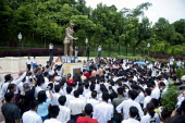People pay their respects at a statue of General Aung San to mark Martyrs' Day in Yangon on July 19 2013 General Aung San and eight other leaders...