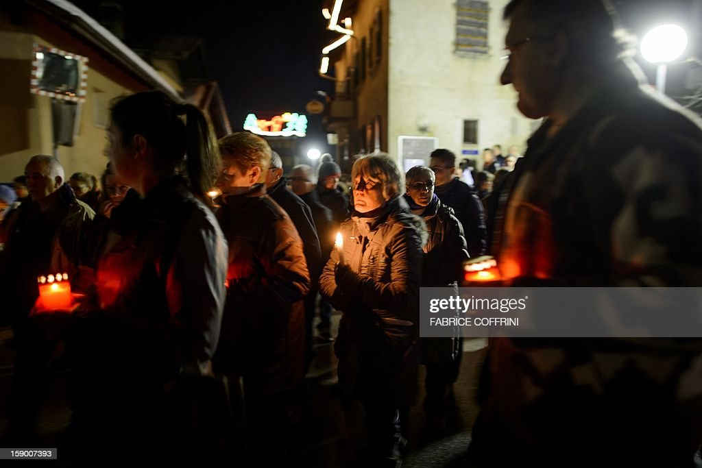 People pay their respects on January, 5, 2013 during a march in memory of the victims of a shooting in the village of Daillon. A gunman with psychiatric and drug problems killed three women and wounded two men on January 3, 2013 in a shooting spree in the tiny village where he lived in the mountains of southern Switzerland. Police shot and wounded the suspect after he threatened them with a gun following the attack in Daillon that raised fresh questions about the country's liberal gun ownership laws.