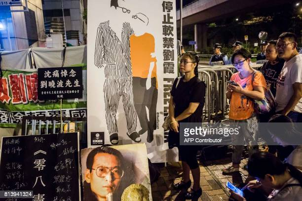 People pay their respects outside the Chinese Liaison Office of Hong Kong after the death of Chinese Noble laureate Liu Xiaobo in Hong Kong on July...