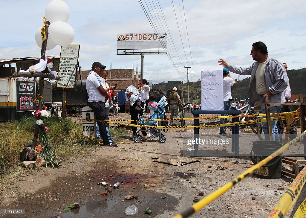 People pay tribute to Luis Orlando Saenz who died on July 12 apparently by firing tear gas during clashes between trucker drivers and riot police on...