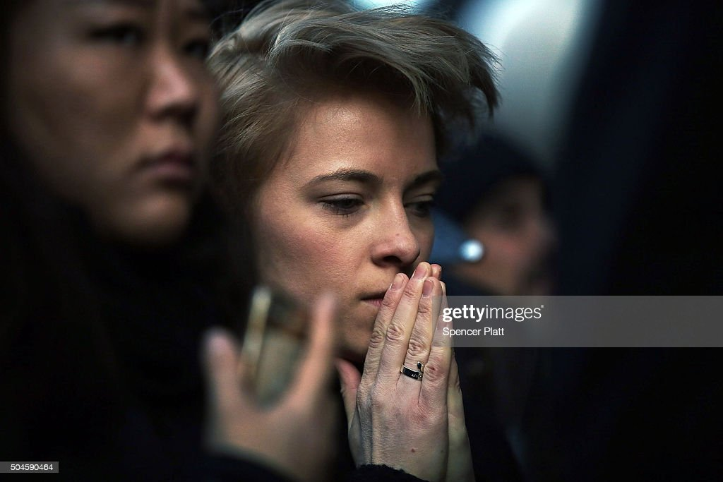 People pay tribute to the late musician and performer <a gi-track='captionPersonalityLinkClicked' href=/galleries/search?phrase=David+Bowie&family=editorial&specificpeople=171314 ng-click='$event.stopPropagation()'>David Bowie</a> outside of the apartment he shared with his wife on January 11, 2016 in New York City. A growing memorial sits outside of the residence in lower Manhattan following news that Bowie died over the weekend following 18 month battle with cancer. Bowie was 69 and had just released his 25th studio album, 'Blackstar,' to strong reviews on January 8.