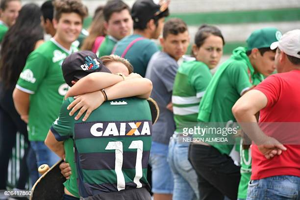TOPSHOT People pay tribute to the players of Brazilian team Chapecoense Real who were killed in a plane accident in the Colombian mountains at the...