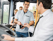 People paying bus fares.