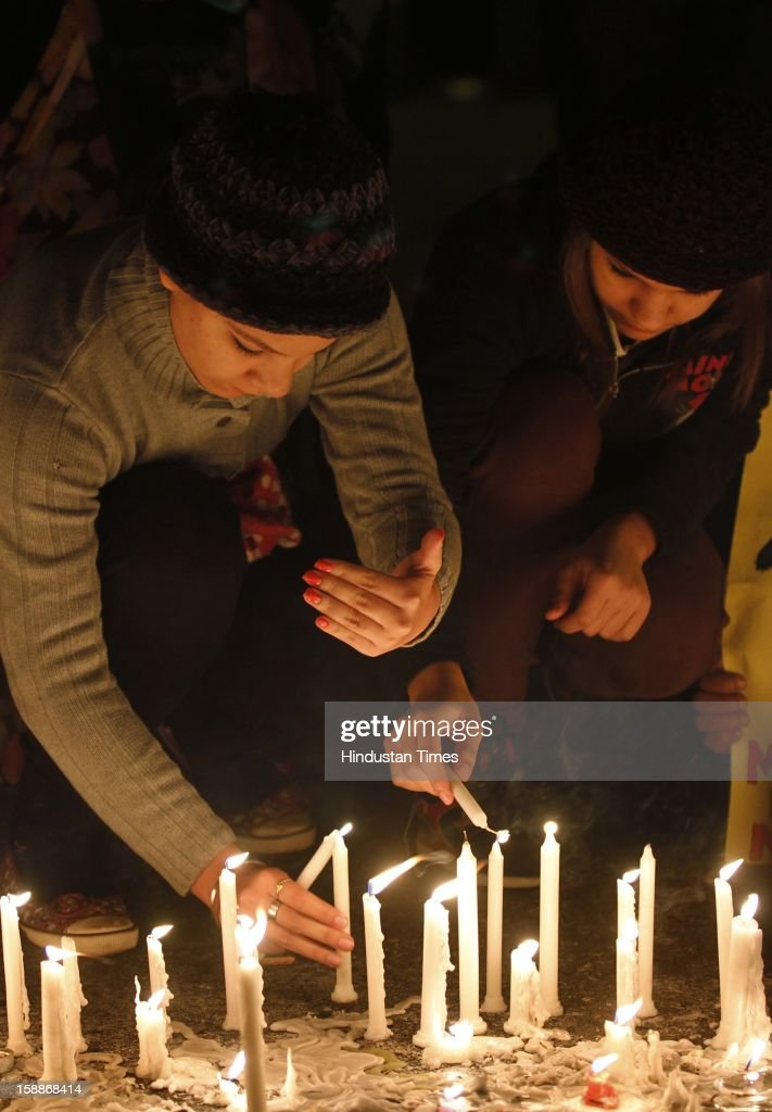 People paying candle light tribute to Delhi gang rape victim at Jantar Mantar to mourn for girl who died of injuries after brutally gang raped in a moving bus on January 1, 2013 in New Delhi, India. The young woman was cremated promptly on Sunday amid an outpouring of anger and grief by millions across the country demanding greater protection for women from sexual violence.