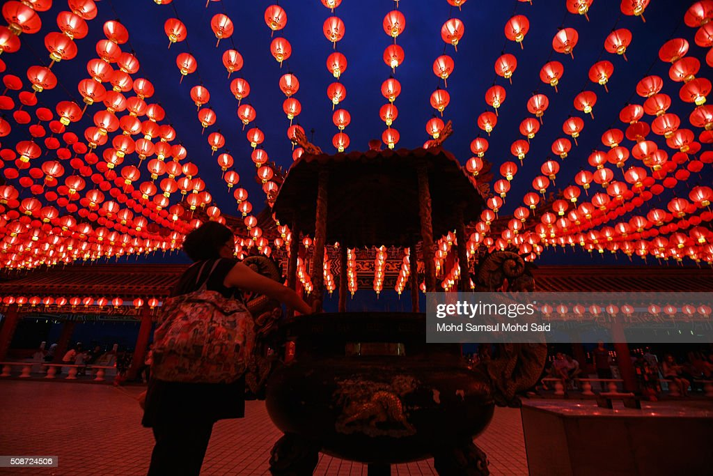 People perform a prayer inside the Thean Hou temple with lanterns decorated ahead of Lunar New Year of the monkey celebrations on February 6, 2016 in Kuala Lumpur, Malaysia. According to the Chinese Calendar, the Lunar New Year which falls on February 8 this year marks the Year of the Monkey, the Chinese Lunar New Year also known as the Spring Festival is celebrated from the first day of the first month of the lunar year and ends with Lantern Festival on the Fifteenth day.