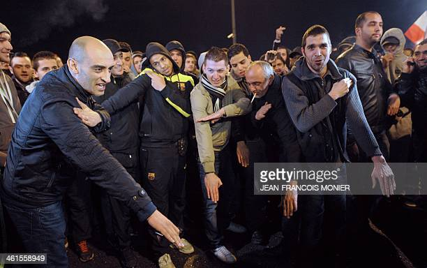 People perform a 'quenelle' salute after the performance of French controversial humorist Dieudonne M'bala M'bala was cancelled on January 9 2014 at...