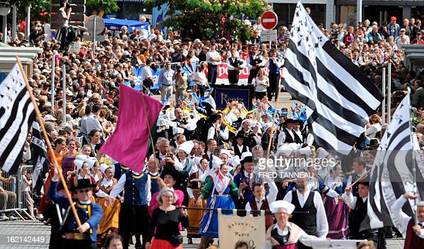 People perform a traditional Breton dance on August 7 2011 in Lorient during the celtics nations Great Parade of the 'festival interceltique de...