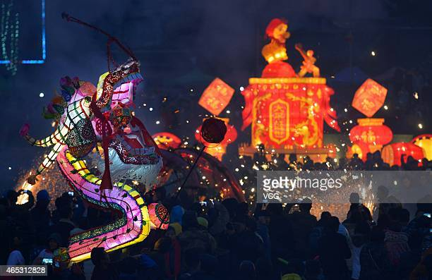 People perform dragon dance at Guyi Square of Buyi and Miao Autonomous Prefecture of QianNan on Lantern Festival on March 5 2015 in Qiannan Guizhou...