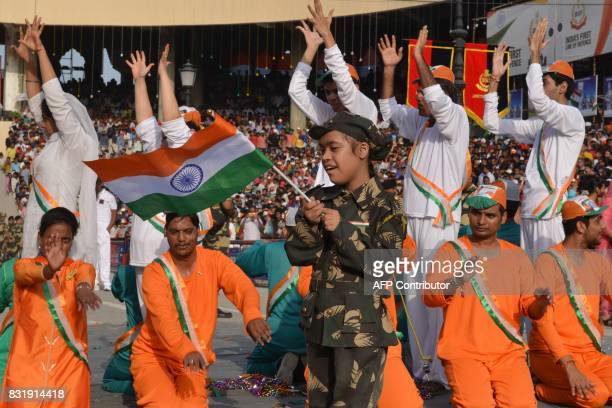 People perform during a ceremony to celebrate 70th India's Independence Day at the IndiaPakistan Wagah border post on August 15 2017 This month marks...