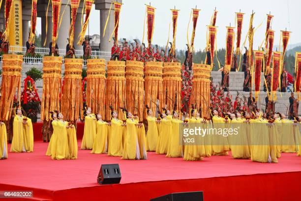 YAN'AN CHINA APRIL 04 People perform during the public memorial ceremony for the Yellow Emperor on April 4 2017 in Yan'an Shaanxi Province of China A...