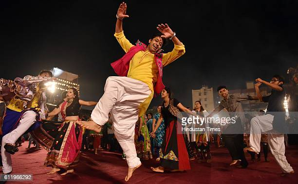 People perform Garba dance on the occasion of the first day of Navratri festival at Chandavarkar Lane near Don Bosco School at Borivali on October 1...