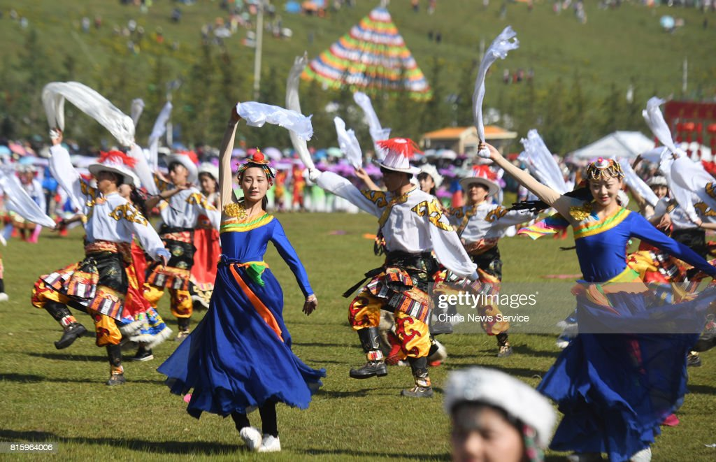 People perform Guozhuang dance during The 18th China nine color Gannan the Shambhala Tourism Arts Festival at Hezuo on July 17, in Gannan Tibetan Autonomous Prefecture, Gansu Province of China. The 18th China nine color Gannan the Shambhala Tourism Arts Festival kicked off on Monday morning in Hezuo city in Gannan. About a thousand people ride horses run across the grassland and over one thousand people perform the Guozhuang dance during the opening of the festival.