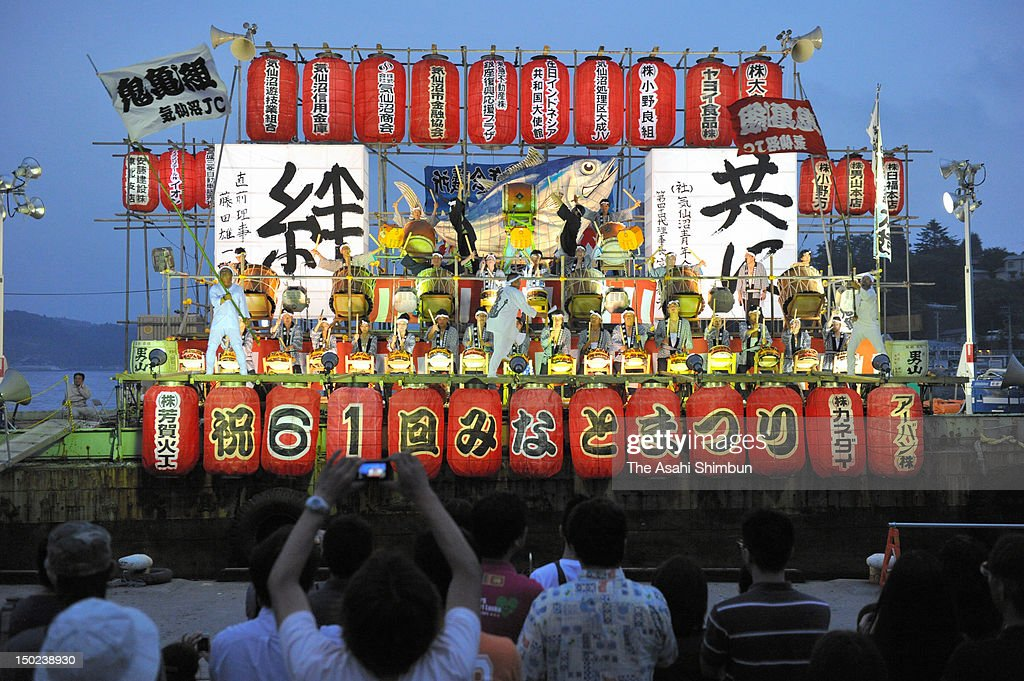 People perform Japanese drums in the ship during the Kesennuma Minato Festival on August 11, 2012 in Kesennuma, Miyagi, Japan. The festival was cancelled last year due to the earthquake and tsunami.