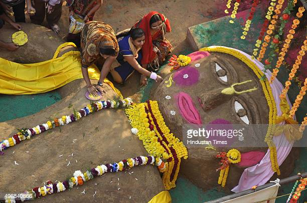 People perform rituals during Govardhan Puja also called Annakut at the ISKCON temple at Raj Nagar on November 12 2015 in Ghaziabad India Govardhan...