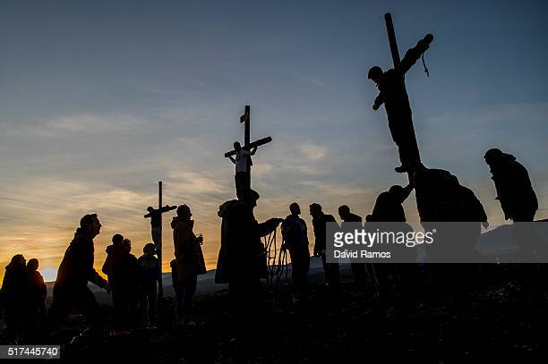 People perform the crucifixion during a rehearsal of the reenactment of Christ's suffering on March 24 2016 in Hiendelaencina Spain Since 1972 the...