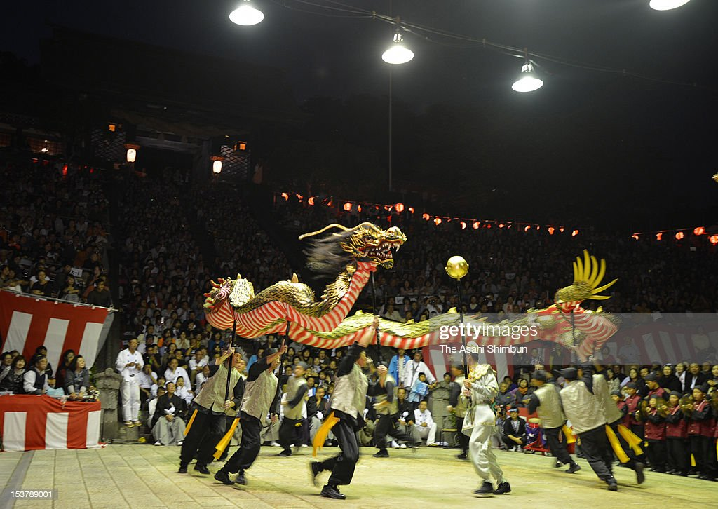 People Perform the 'Ja Odori' or dragon dance during the Nagasaki Kunchi Festival at Suwa Shrine on October 7, 2012 in Nagasaki, Japan. The festival has 378 years tradition.