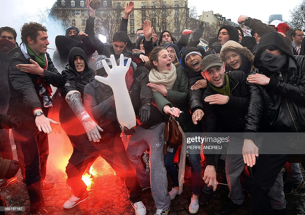 People perform the 'quenelle' gesture popularised by a French controversial comedian and condemned as antiSemitic during a demonstration called by...