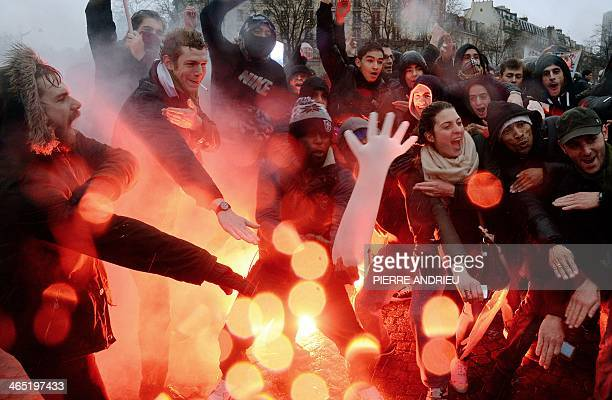 People perform the 'quenelle' gesture popularised by a French controversial comedian during a demonstration called by the Collective 'Day of Anger'...