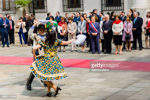 People perform the traditional dance 'Cueca' during the Esquinazo as part of the celebrations of Independence Day at Patio de los Cañones on...