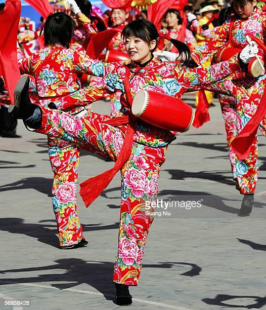 People perform the waist drum dance at a parade to mark the Chinese Lantern Festival holiday on February 11 2006 in Ansai County Yanan City Shaanxi...
