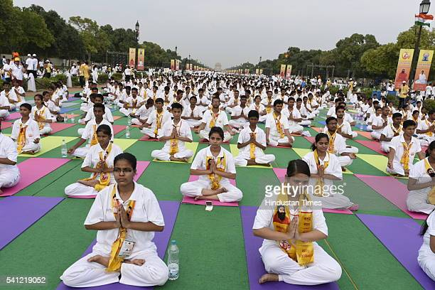 People perform yoga during the rehearsals for the upcoming International Yoga Day at Rajpath on June 19 2016 in New Delhi India International Yoga...