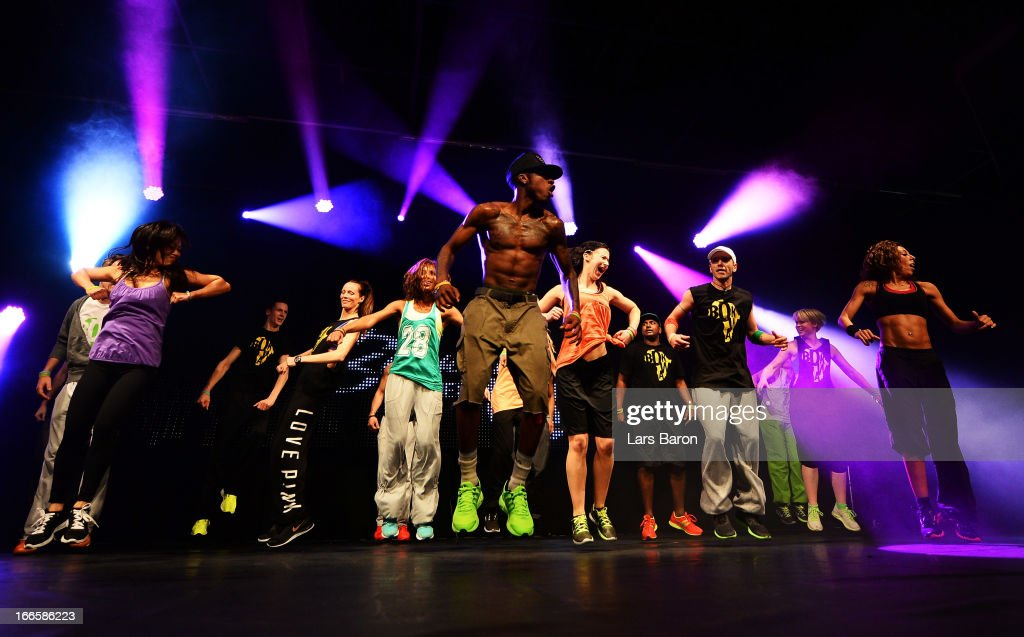 People performe during a BOKWA training session during the FIBO 2013 on April 14, 2013 in Cologne, Germany.
