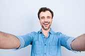 People person business refreshment success fortune concept. Close up portrait of cheerful excited amazed surprised, casual jeans denim clothes, taking self picture isolated on gray background