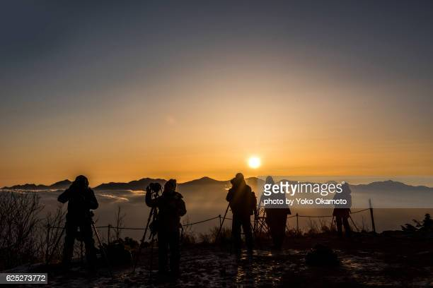 People photographing the rising sun from the Southern Alps
