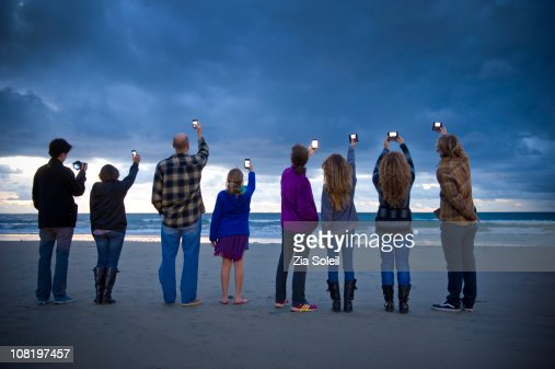 people photographing the sunset with smart phones : Stock Photo