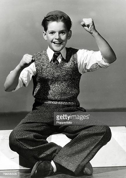 circa 1940's A young teenage boy from New York gives an enthusiastic response to the camera