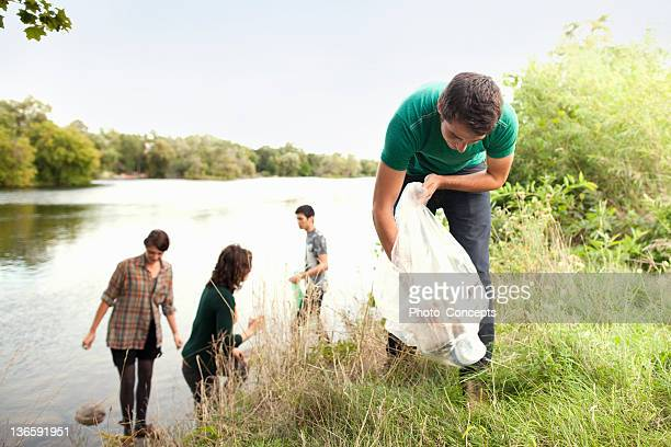 People picking up garbage in park