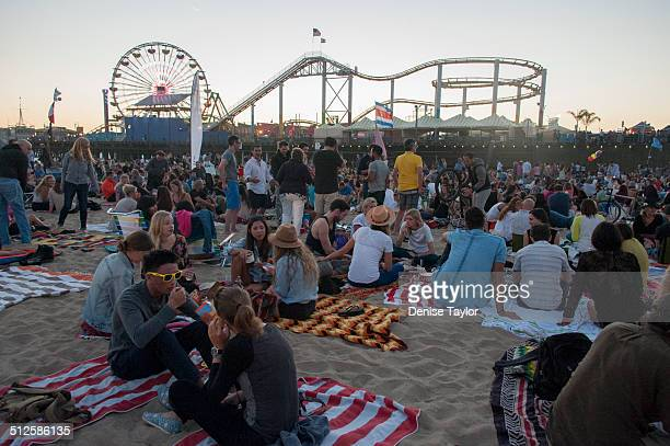 People picnic in the sand at the Santa Monica pier's twilight concert held every Thursday night during the summer August 21 2014