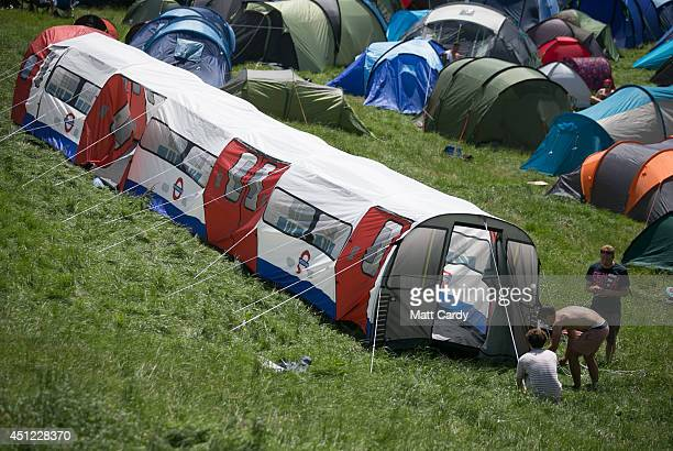People pitch a London Underground train tent in the camping fields at Worthy Farm in Pilton on the first day of the 2014 Glastonbury Festival on June...