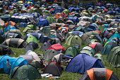 People pitch their tents in the camping fields at Worthy Farm in Pilton on the first day of the 2014 Glastonbury Festival on June 25 2014 in...