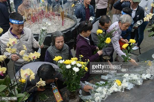 People place flowers and incenses sticks during a small rally marking the 38th anniversary of the Chinese war border against Vietnam in front the...