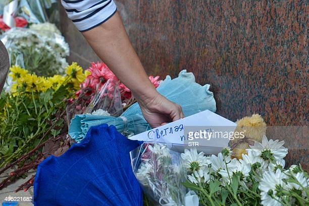 People place flowers and messages in front of the Russian ambassy in Cairo to pay respect to the victims of a Russian airliner that crashed in...
