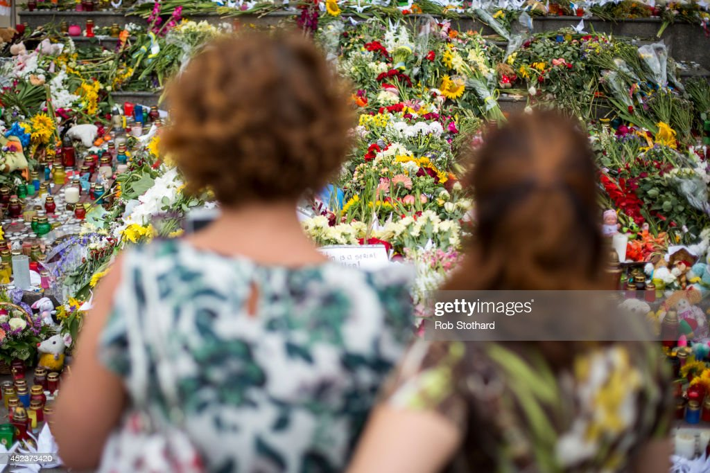 People place flowers, candles and other tributes in front of the Netherlands Embassy in memory of the victims of Malaysia Airlines flight MH17 on July 19, 2014 in Kiev, Ukraine. Malaysia Airlines flight MH17 was travelling from Amsterdam to Kuala Lumpur when it crashed killing all 298 on board including 80 children. The aircraft was allegedly shot down by a missile and investigations continue over the perpetrators of the attack.
