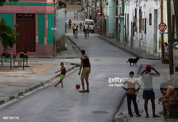 People play a game of soccer in the streets as Pope Francis spends his first night in the country on September 19 2015 in Santiago de Cuba Cuba Pope...